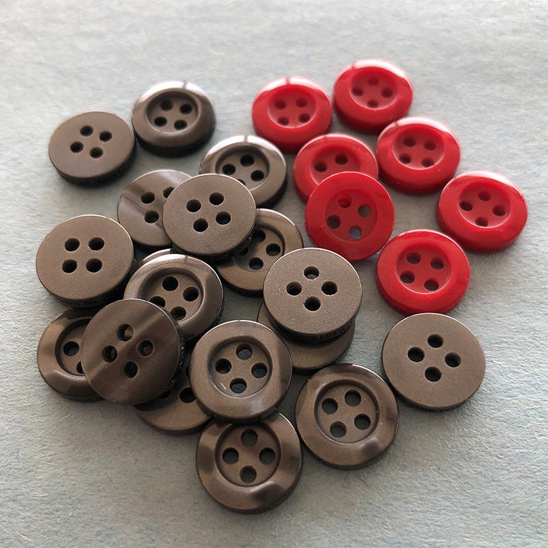 Polyester buttons for knitwear and garment manufacturers